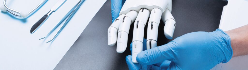 Hand with blue gloves touching a robotic hand